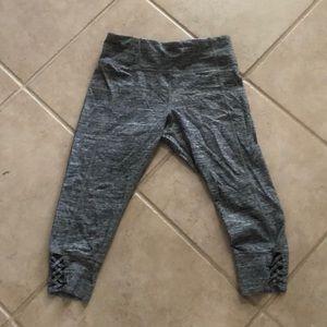 gray Calvin Klein leggings with braiding detail